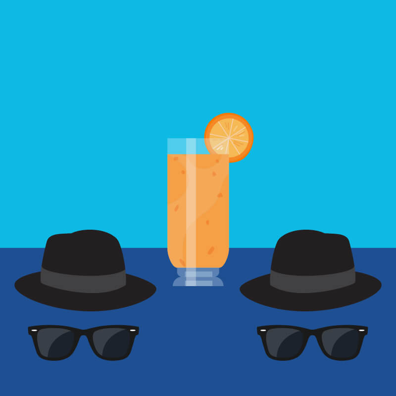 Blue background with tall orange cocktail, two fedora hats and two sets of sunglasses
